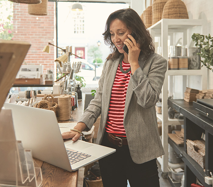 Woman business owner working on laptop