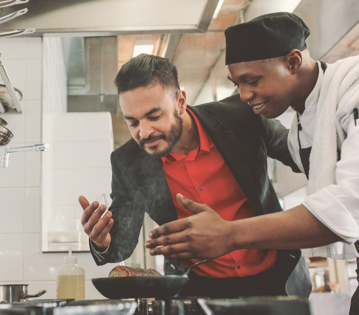 Restaurant owner working with chef